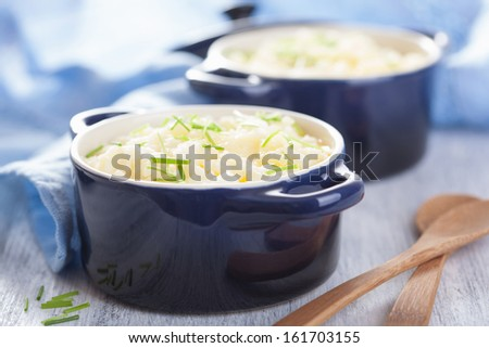 mashed potatoes in small pots  - stock photo