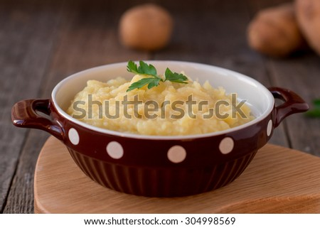 mashed potatoes on vintage rustic wooden background - stock photo