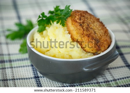 mashed potatoes with fried cutlet on a wooden table - stock photo