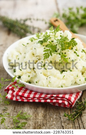 Mashed potatoes with herbs - stock photo