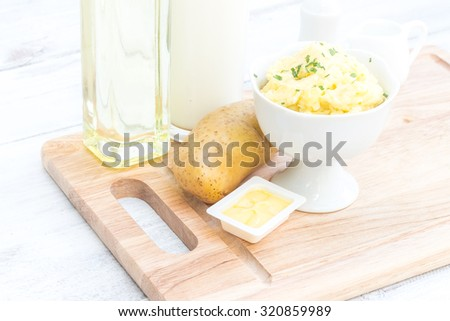 Mashed potatoes with ingredients in cooking. - stock photo