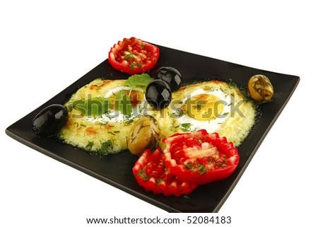 mashed potatoes with vegetables on black dish over white - stock photo