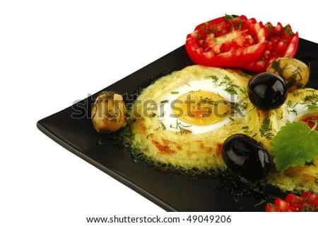 mashed potatos with fried eggs on black - stock photo