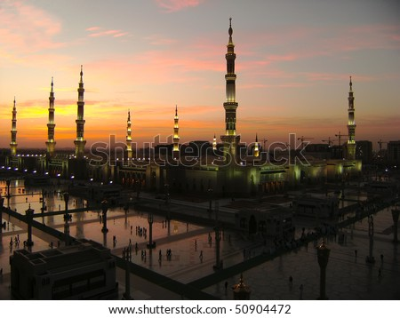 Masjid Al Nabawi or Nabawi Mosque (Mosque of the Prophet) in Medina (City of Lights), Saudi Arabia at dawn. - stock photo