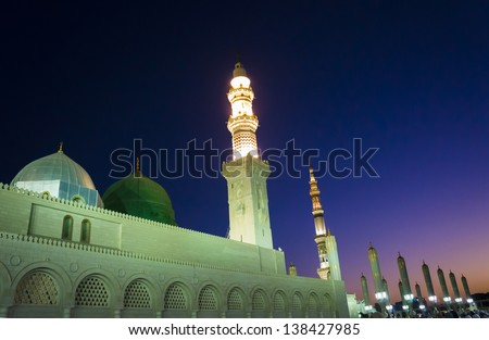 Masjid (Mosque) Nabawi at sunrise in Al Madinah, Kingdom of Saudi Arabia. - stock photo