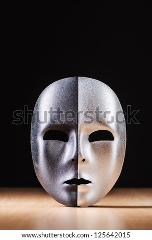 Mask against the dark background - stock photo
