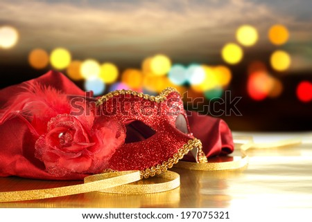 mask and red satin  - stock photo