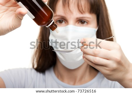 Mask doctor hand holding medicine healthcare syrup - stock photo