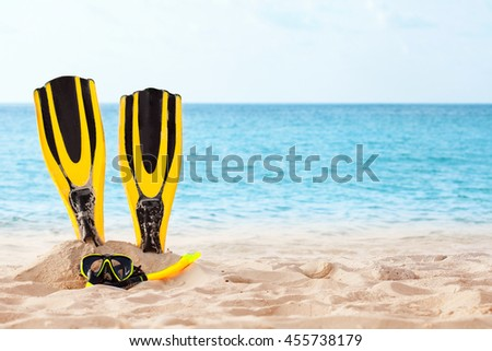 Mask with snorkel and flippers on the beach - stock photo