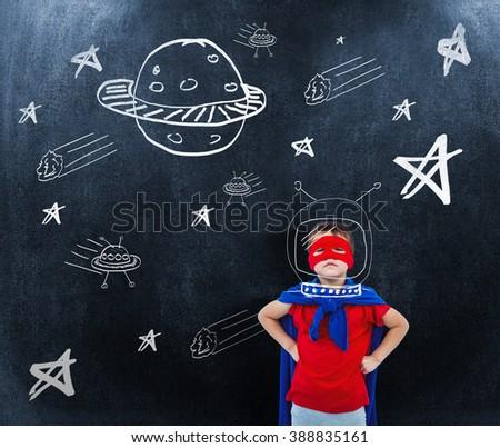 Masked boy pretending to be superhero against black background - stock photo