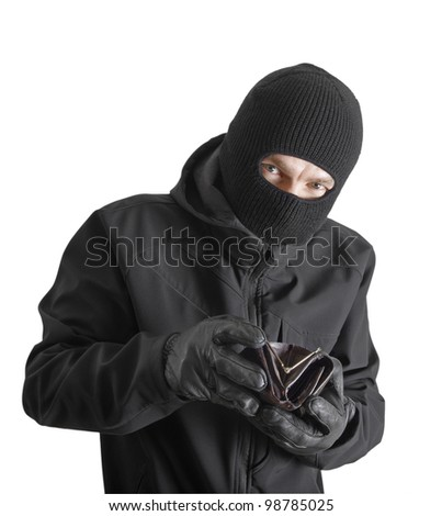 Masked criminal holding a stolen leather purse, isolated on white - stock photo
