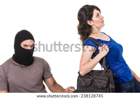 masked male thief robbing beautiful young girl with hand bag isolated on white - stock photo