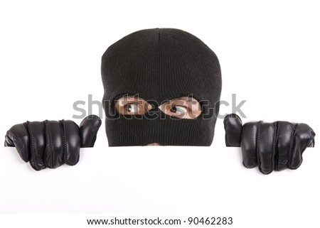 masked man appeared from below with an expression of surprise - stock photo