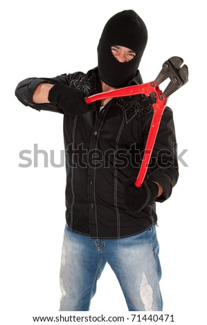 Masked robber holding huge red and black wire cutters - stock photo