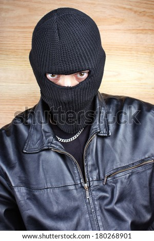 Masked thief in balaclava bandit gangster - stock photo