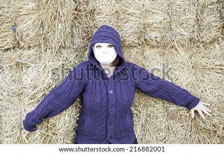 Masked woman in barn farm, halloween - stock photo