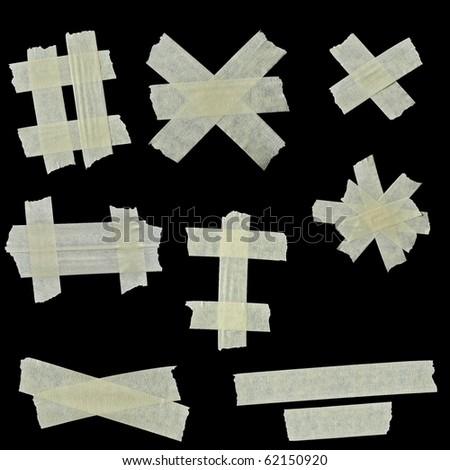 masking tape isolated on black background - stock photo