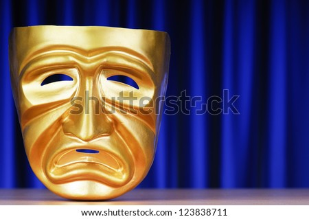 Masks with the theatre concept - stock photo