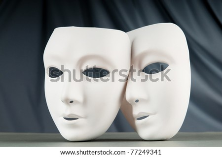 Masks with theatre concept - stock photo