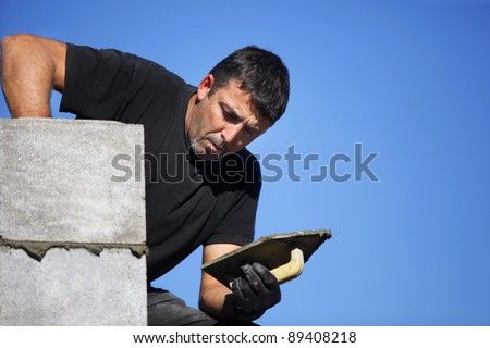 Mason building wall - stock photo
