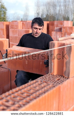 mason on a construction site - stock photo