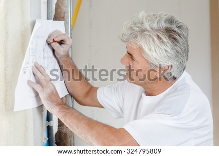 Mason writing something - stock photo
