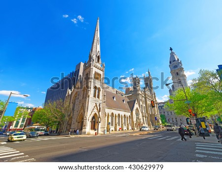 Masonic Temple and street in the Old City in Philadelphia, in Pennsylvania, the USA. Tourists in the street. The Temple is placed near City Hall - stock photo