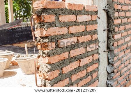 masonry brick wall : small building home construction detail - stock photo