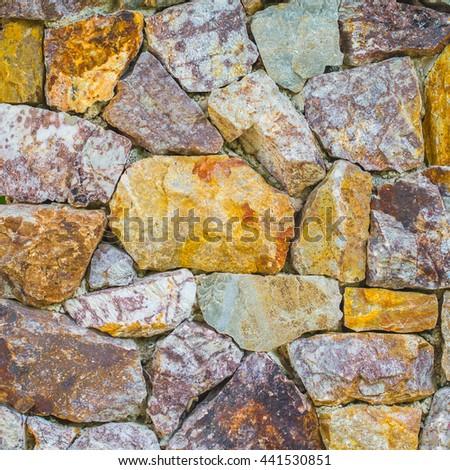 Masonry rock wall texture - stock photo