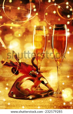 Masquerade mask and champagne. Happy New Year! - stock photo