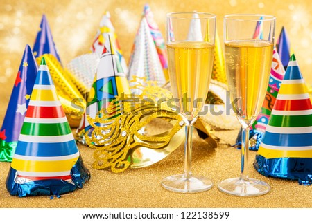 Masquerade Mask with champagne and party hat. Happy New Year. - stock photo