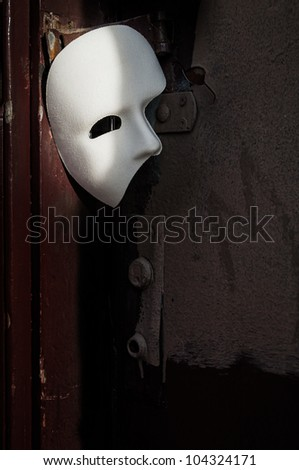 Masquerade - Phantom of the Opera Mask on Vintage Door - stock photo