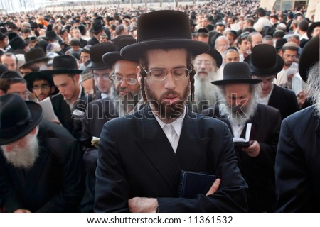 Mass prayer of Jews on the holiday Pesakh in the wailing wall in Jerusalem. - stock photo