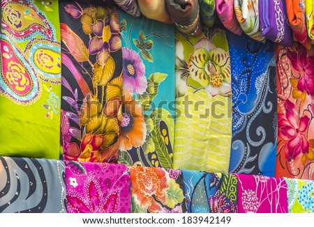 Mass produced colored textile in a traditional east market in Malaysia
