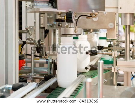 Mass production of plastic bottles - stock photo
