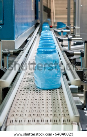 Mass production of plastic containers - stock photo