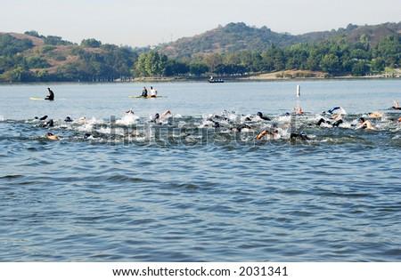 mass start of triathlon competition - stock photo