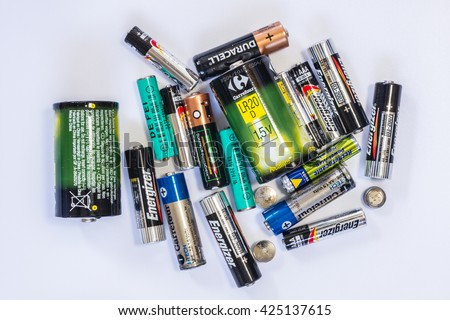 Massa, Italy - May 16, 2016: A group of used and out of power batteries of different type and size on a white ground