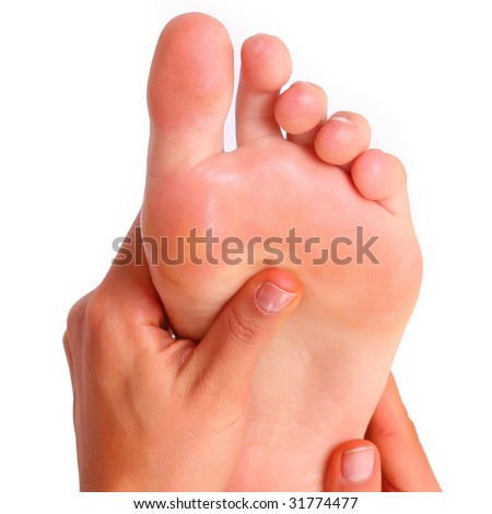 Massage and leaving of the female feet bared by a foot, isolated on a white background, please see some of my other parts of a images   - stock photo