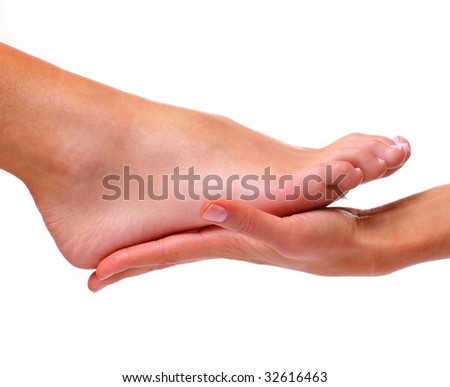 Massage and leaving of the female feet bared by a foot, isolated on a white background, please see some of my other parts of a body images