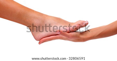 Massage and leaving of the female feet bared by a foot, isolated on a white background, please see some of my other parts of a body images - stock photo