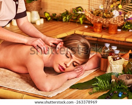 Massage in  beauty spa. Still life and water pool in foreground. - stock photo