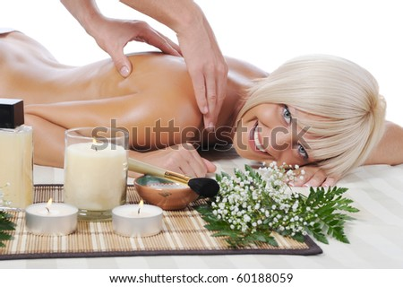 Massage in the spa salon. Isolated on white background - stock photo