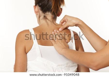 Massage of back on white background - stock photo