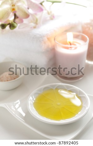 Massage oil and aroma candle for spa image