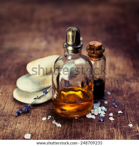 Massage oil and zen stones. Shallow DOF  - stock photo