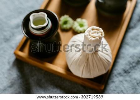 Massage series : Massage amenities kit in wooden tray - stock photo