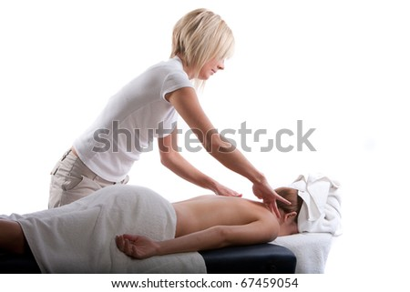 Massage therapist doing a back massage - stock photo