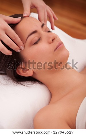 Massage treatment in the head of an asian woman - stock photo