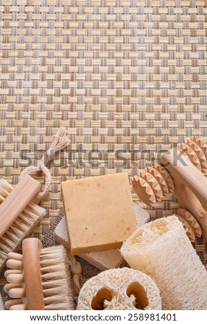 massager bar soap loofah nail brush on wicker background with copyspace  - stock photo